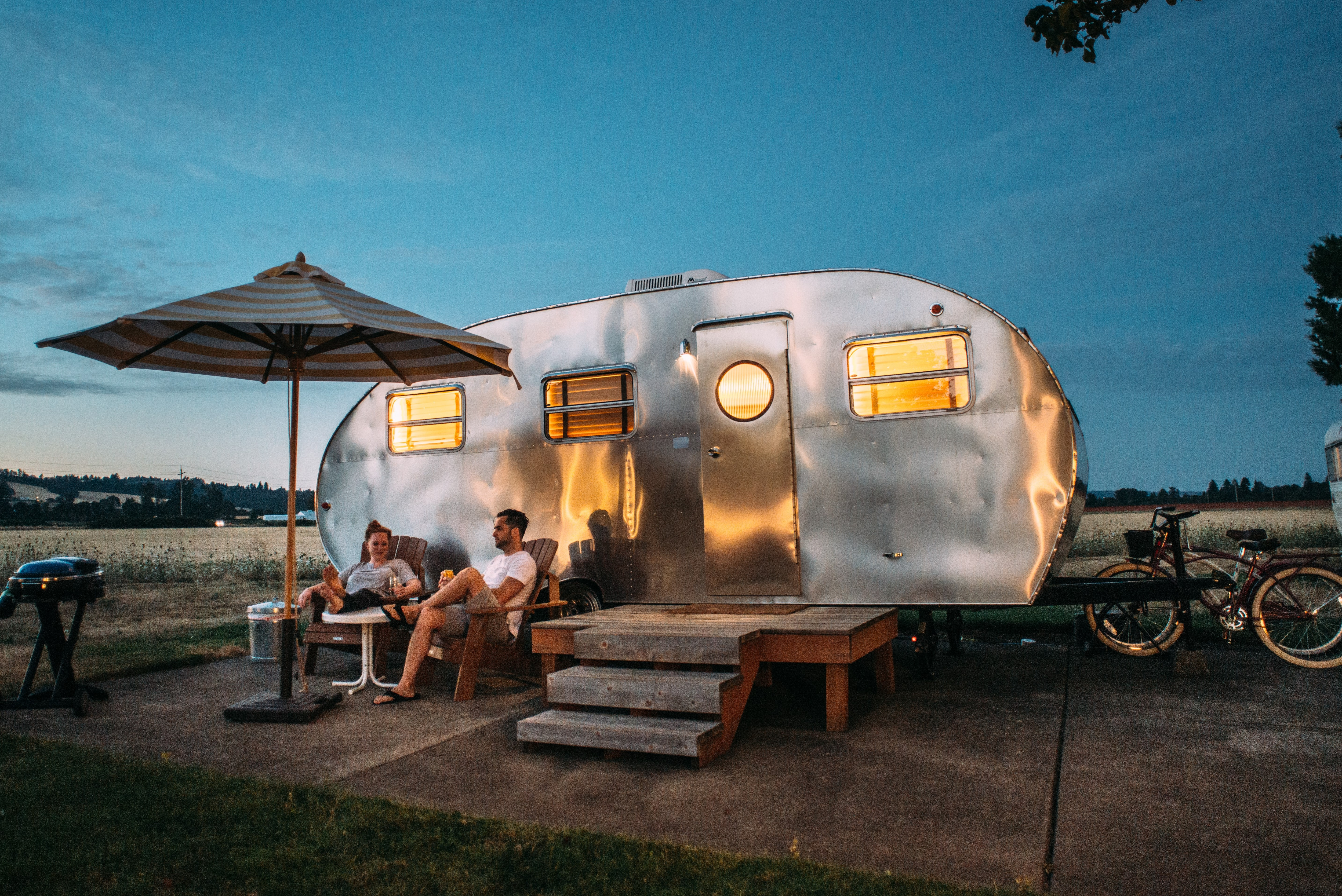 A couple camping with their trailer